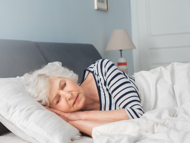Tired Mature Woman Relax Sleeping In Comfy Bed Stock Photo
